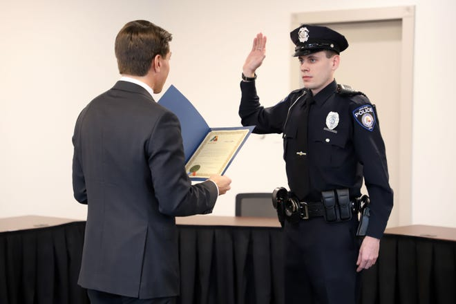 Mayor Matt Miller swears in Officer Micah Watts to the Ashland Police Division on Monday, bringing the division up to full staff. Watts will now begin his 14 weeks of field training.