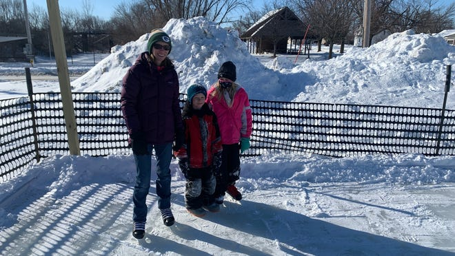 Teresa Dalton with daughter Abby and son Elliot at the newly opened Huxley Parks and Rec Outdoor Ice Rink by Bella Homes, west of the fire station, at 104 E. Railway St. Admission is free.