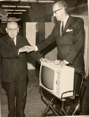 """Willie """"June Bug"""" Frank, a longtime employee of Augusta's old J.B. White's Department Store, is congratulated for his longevity with the company."""