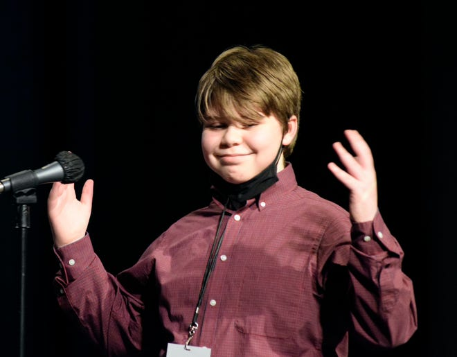 Kennedy Middle School student Liam King celebrates winning the Aiken County district spelling bee at the Amentum Center for Performing Arts in Aiken, S.C. on February 1, 2021.
