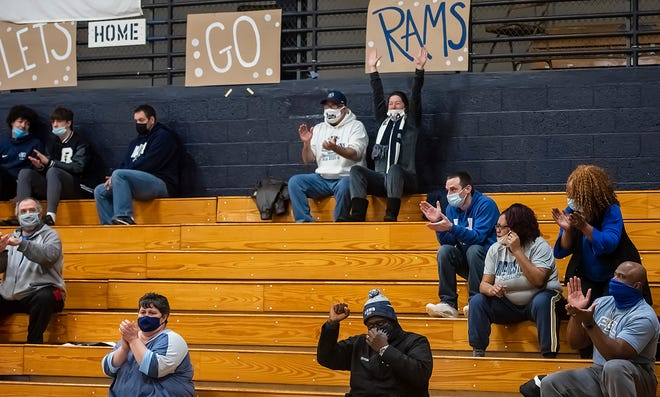 Rochester High School girls basketball families wear masks and sit far apart in the stands during the Rams' game Monday at Rochester High School.
