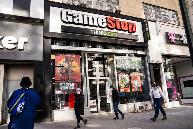 Pedestrians pass a GameStop store on 14th Street at Union Square, Thursday, Jan. 28, 2021, in the Manhattan borough of New York. GameStop shares are on track for their biggest one-day loss ever, extending a skid that's cleaved off some of its recent blockbuster gains following a social-media led campaign to get the videogame retailer's stock to skyrocket. Shares were down 46% to about $120 in morning trading Tuesday, Feb. 2, following a 31% decline a day earlier.