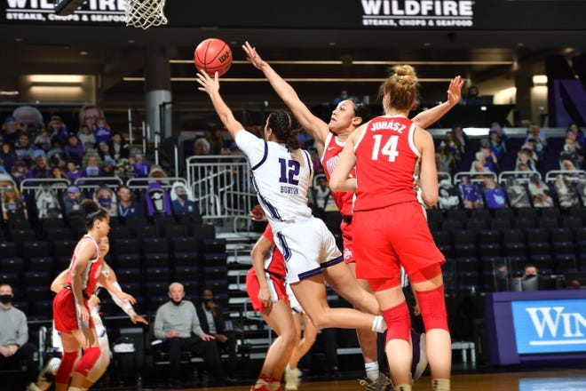 Northwestern guard Veronica Burton (12) puts up a shot over Ohio State's Braxtin Miller (10) in the Wildcats' 69-57 victory on Monday, Burton led all players with 20 points, 15 rebounds and nine assists.