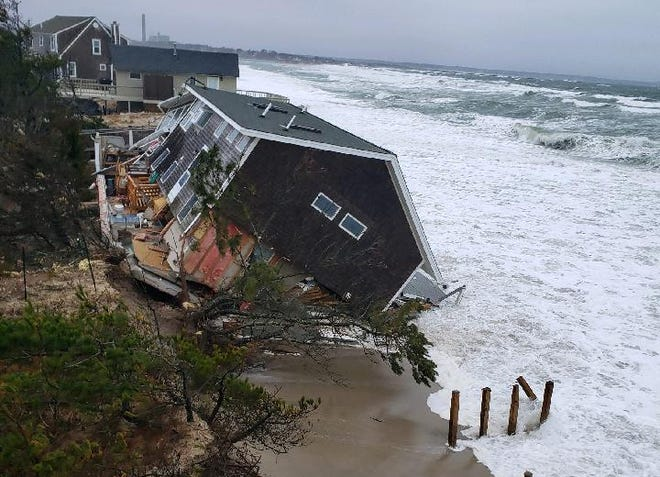 A home on Salt Marsh Road collapsed into the ocean late Tuesday afternoon. The home, which sustained heavy damage in Monday's storm, sits in an area that has been battered by beach erosion over the years. [Photo courtesy of Mike Pottey]