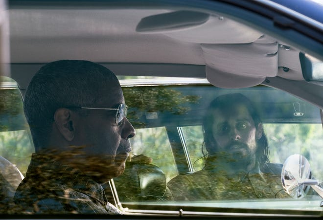 """This image released by Warner Bros. Pictures shows Denzel Washington and Jared Leto in a scene from """"The Little Things."""" (Nicola Goode/Warner Bros. Pictures via AP)"""