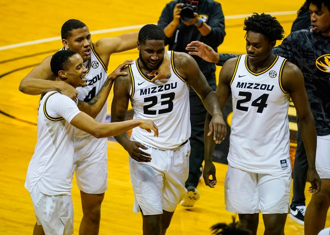 Missouri forward Jeremiah Tilmon (23) is congratulated by guard Xavier Pinson (1), guard Javon Pickett (4) and forward Kobe Brown (24) after defeating Bradley on Dec. 22 at Mizzou Arena.
