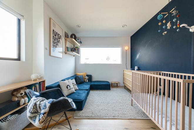 """Rachel Magana, senior visual designer at the sustainable furniture-rental company Fernish, says she picked up some cosmological decorating ideas from a colleague's recent nursery project. """"Base your color palette around deep blue tones, then splash in bits of color like yellow, white or red."""""""