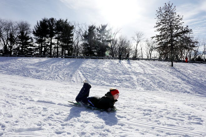 Abby Day, 13, of Worthington, rides a sled at Olentangy Park in Worthington on Tuesday.
