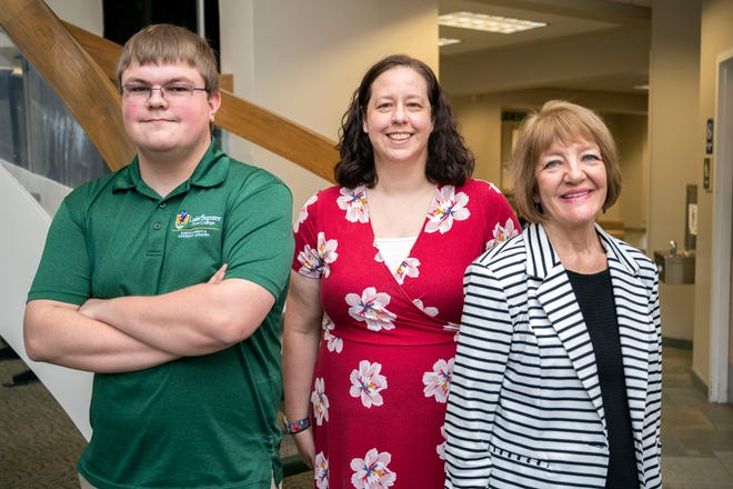 Jenni Kotowski, executive director of enrollment management at Lake-Sumter State College, is flanked by enrollment coaches Andrew Brinkley and Sandy McShane.