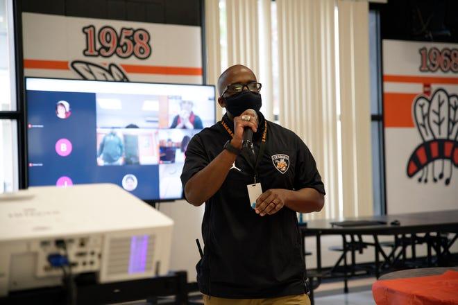 Leesburg High School Principal Michael Randolph recognizes new teachers at an event.