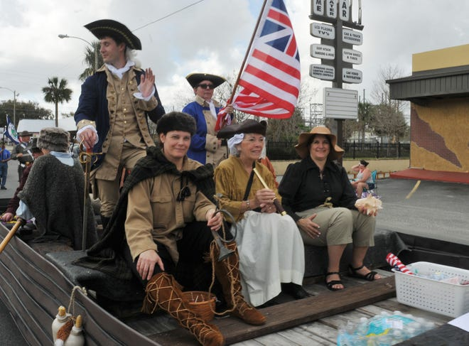 A float goes down Bay Street in 2018 during the Georgefest parade in Eustis.