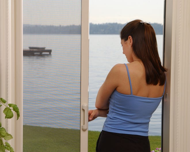A retractable screen door over the opening half of a sliding glass patio door can really help ventilate your home.
