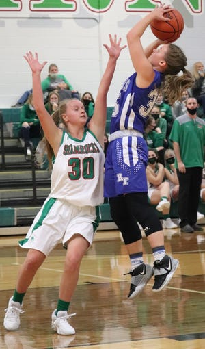 Buckeye Trail's Brooke Baird (30) gets off a shot over Barnesville''s Rylee Stephens (30) during a game earlier in the season. Area teams got their OHSAA postseason assignments during drawings held on Sunday afternoon.