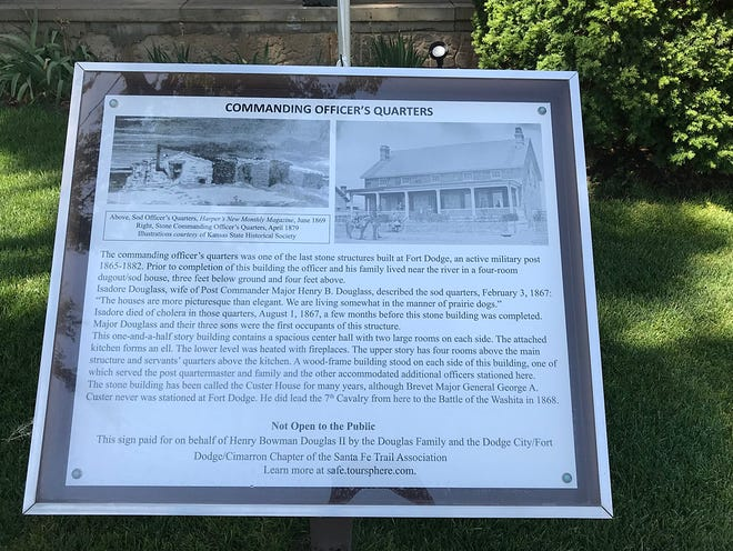 The storyboard about the Custer House in Fort Dodge sits in front of the commanding officer's home.