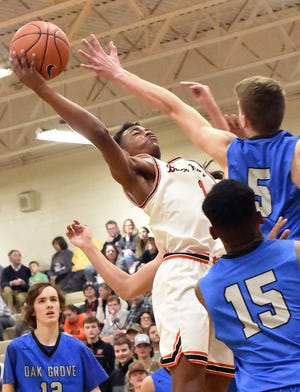 North Davidson's Jamarien Dalton reaches back on a shot attempt while Oak Grove's Colby Landfried plays defense during a game in the 2019-20 season. Dalton scored a school-record 50 points in the Black Knights' 86-61 win over Thomasville on Friday. [David Yemm for The Dispatch]