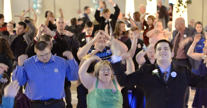 "Guests dance to the song ""YMCA"" during the Tim Tebow Foundation's Night To Shine Prom held at St. John's Banquet & Conference Center in Girard on Feb. 7, 2020. Erie Night to Shine this year will take place Feb. 12 as a ""Shine-Thru"" resembling a drive-through parade with several stations at Our Lady of Peace."