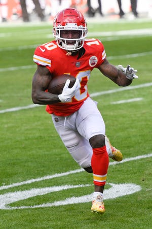 Kansas City Chiefs wide receiver Tyreek Hill (10) runs after a catch against the Cleveland Browns during a playoff game. Hill wants to be the Super Bowl halftime show. Hill said Monday he'd be willing to race Tampa Bay receiver Scotty Miller during intermission Sunday at Raymond James Stadium in Tampa.