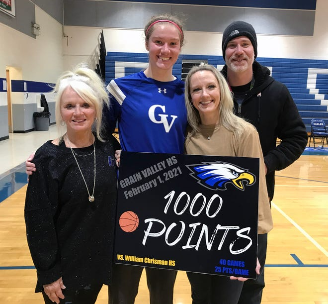 Grain Valley sophomore Grace Slaughter was joined by family members, from left, grandmother Brenda Cianciolo, her mom Becky and dad Brian Slaughter, after she scored her 1,000th career point in just her 41st career high school game. Slaughter leads the metro area with a 29.5 points-per-game average. Despite her 15 points, the Eagles fell 51-37 to William Chrisman.
