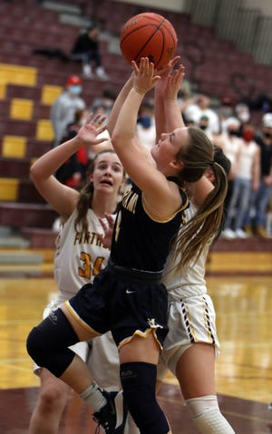 Notre Dame High School's Reagan Engberg (4) goes up for a basket during their game against Mount Pleasant High School, Monday Feb. 1, 2021 at Mount Pleasant.