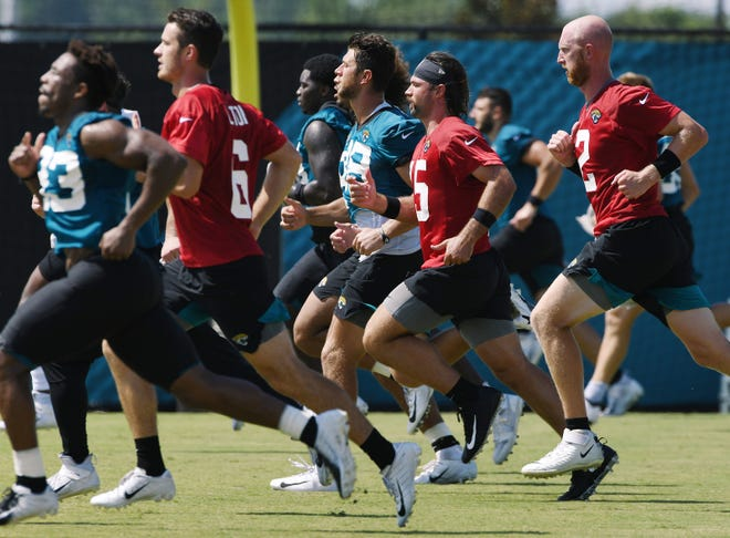 Jacksonville Jaguars players run sprints near the end of Thursday morning's practice session during training camp held at the practice fields outside TIAA Bank Field in Jacksonville, Florida Thursday, August 13, 2020. [Bob Self/Florida Times-Union]