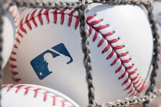 MLB players remain scheduled to report to spring training in two weeks, with the full 162-game schedule set to begin April 1.