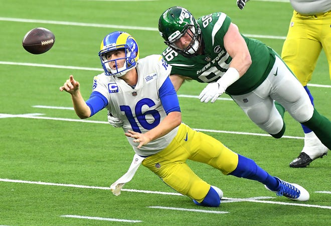 Los Angeles Rams quarterback Jared Goff tries to get a pass off but is sacked by New York Jets defensive lineman Henry Anderson in the fourth quarter at SoFi Stadium in Inglewood, Ca., on Dec. 20, 2020.