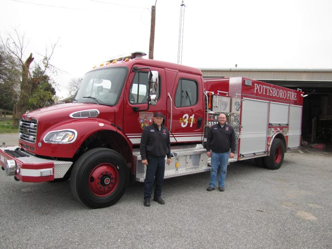 Fire Chief Donnie Glenn and Assistant Chief Brenden McCloud stand with the new pumper/tender/