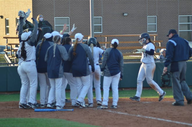 Grayson College's JT Smith is greeted at home plate after a home run against Carl Albert.