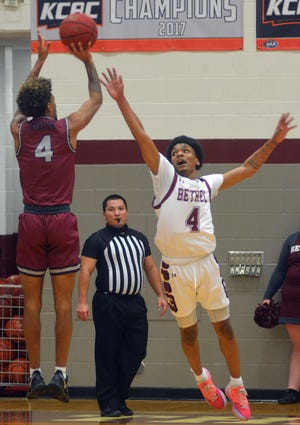Bethel sophomore Kevon Green challenges a shot by Sterling sophomore Rashid Washington during KCAC play Monday.