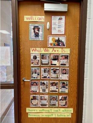 Sandra Petrash, the kindergarten teacher at Wilcox Primary School, has her door decorated as part of the Black History Month activities at the school.