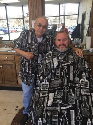 Barber Joe Lozenski receives a visit recently from Leavenworth County Sheriff Andy Dedeke. The barbershop at the Price Chopper store closed this past weekend after being operated by Lozenski for 23 years.