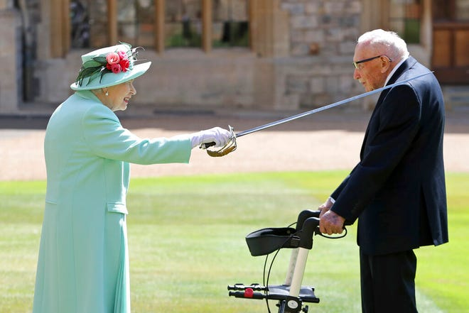 Captain Sir Thomas Moore receives his knighthood on July 17, 2020, from Britain's Queen Elizabeth, during a ceremony at Windsor Castle in Windsor, England.