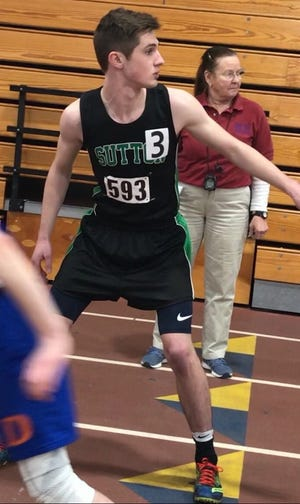 Sutton High's Brian Dunn gets ready to take the baton in an indoor relay.