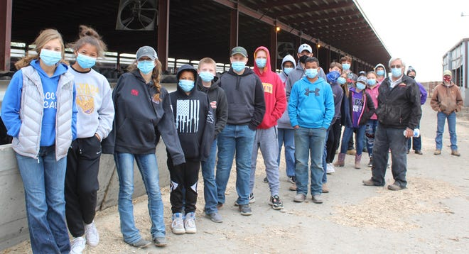 Nevada Middle School Discovery 8 ag students take a field trip to Couser Cattle Company feedlot. Pictured,front to back, are Keegan Mather, Keely Williams, Abbie French, Isaiah Joe, Wyatt Toot, Gage Dunahoo, Nate Maier, Damien Carter, Riley Murphy, Quincy Mohr, Carson Reed, Isabelle Barker, Dakota Hastings, Amara Ose, Trevor Hansen, Jax Knop, Mackenzie Arends, Kaine Albright and Bill Couser, standing next to the line of students. Not picutred: Kevin Cooper, Nevada High School agriculture education instructor and FFA advisor.