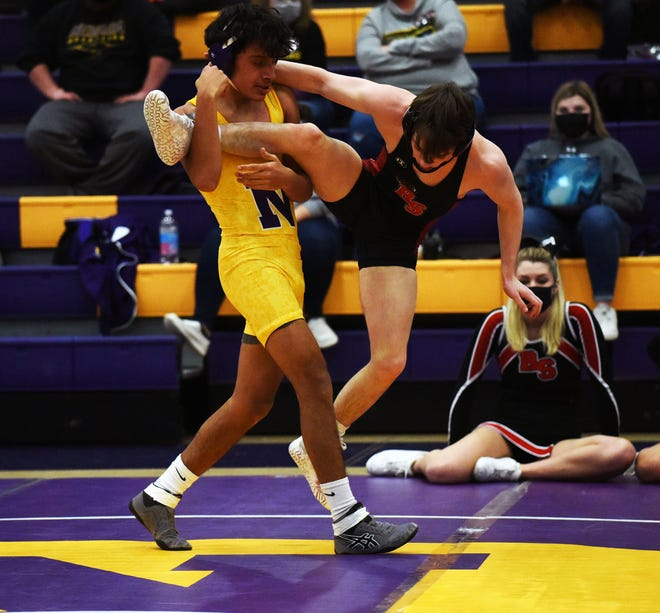 Nevada's Luis Lopez goes for a single-leg takedown on Roland-Story's Colin Streit during their match at 132 pounds Jan. 28 at the Nevada quadrangular dual meet in Nevada. Lopez won by a 9-0 major decision.