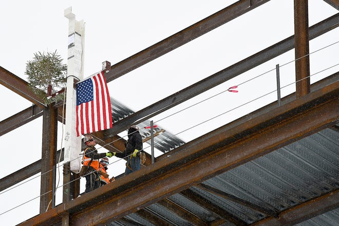 "On Tuesday morning the final steel beam was placed during a ceremonial ""topping off"" event at the Mohawk Valley Health System's downtown Utica hospital location."