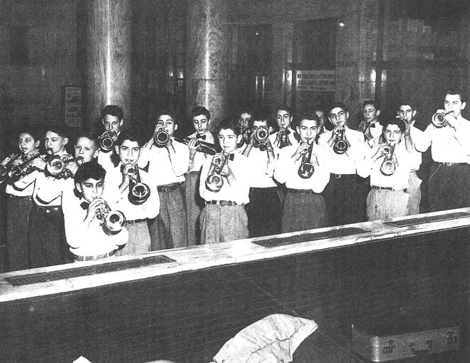 """Utica's Union Station was a busy place during World War II with hundreds of traveling servicemen and women each day visiting the USO rooms on the southwest corner of the station for a sandwich, cup of coffee or to write a letter home. Occasionally, they would be greeted by youngsters studying the trumpet. Students playing one day at the station were Tony """"Red"""" Ricco (who submitted this photo to the Observer-Dispatch years ago), Bob Borgovini, Frank Pellegrino, Dan Falatico, Tom Longeretta, Leonard Bonamassa and W. DeFazio."""