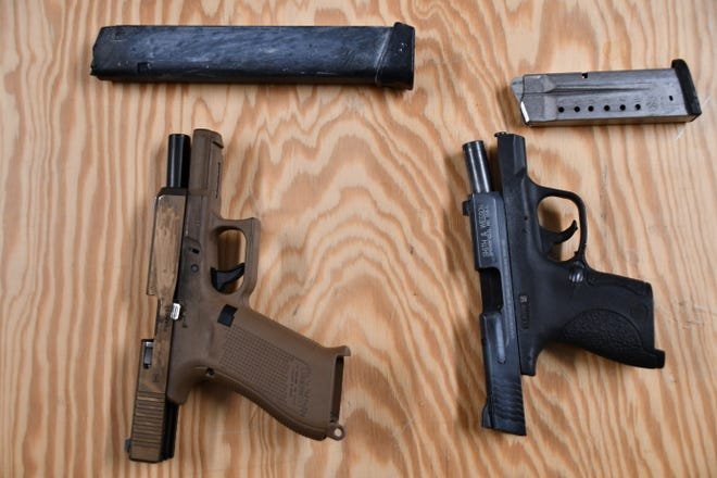 Two handguns and clips Rome police said were seized Friday, Jan. 29, 2021 at a Rome convenience store during the filming of a music video.