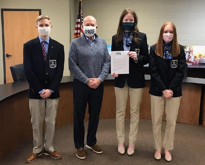 Alma Distributive Education Clubs of America members Colton Wormke, Emily Hatley and Leah Stephens recently met with Alma Mayor Jerry Martin as he proclaimed the month of February Career and Technical Education Month in Alma.