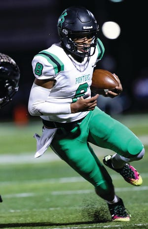 Van Buren senior quarterback Gary Phillips escapes the grasp of a Jonesboro defender during the first round of the Class 6A playoffs on Nov. 13, 2020, at Cooksey-Johns Stadium. Phillips signed his commitment to join the United States Military Academy and the Black Knights football program.