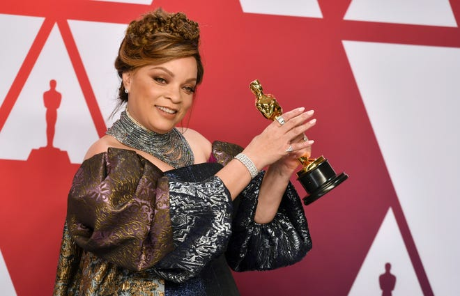 """Ruth E. Carter poses with the award for best costume design for """"Black Panther"""" in the press room at the Oscars on Sunday, Feb. 24, 2019, at the Dolby Theatre in Los Angeles. (Photo by Jordan Strauss/Invision/AP)"""