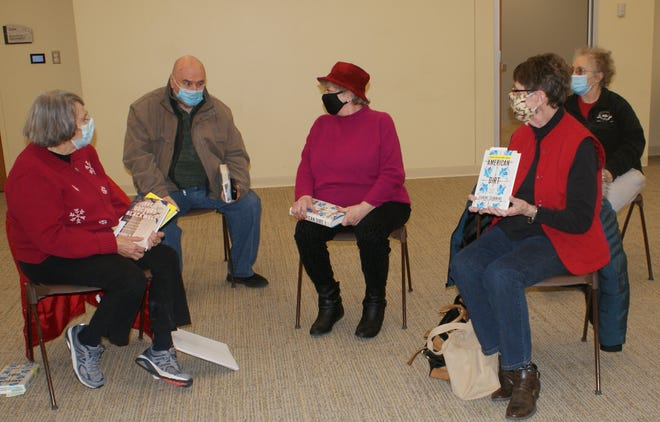 """From left, Next Chapter adult book group members Sue Meisner of Forest City, Gordon Petry of Pekin, Bonnie Dentino of Pekin, Mary Ann Russell of Pekin, and Connie Lenox of South Pekin discuss Jeanine Cummins's 2020 novel, """"American Dirt."""""""
