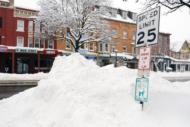 Snow piles up on the side of Main Street in Stroudsburg Borough on Tuesday after a 48-hour snow storm hit the Poconos.