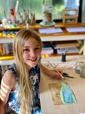 """Sarah Rhinehaart, 10, of Jupiter, poses with painting of a girl by a lake that won the """"Spider's Corner"""" competition in Cricket magazine."""