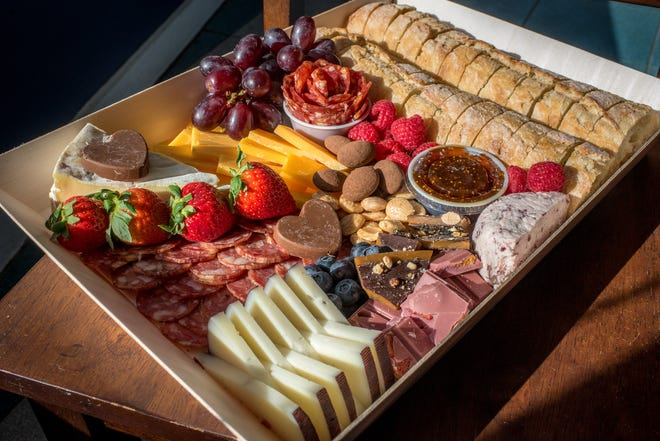 A special Valentine's cheese display now ready to order at Edgewood Cheese Shop, an artisan cafe  in Cranston. It comes with meats, fruit, chocolates and sliced baguette.