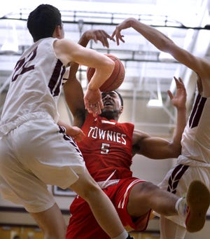 Brian Taylor (shown in action from last year) and the East Providence boys basketball team won a thriller in overtime against Portsmouth Tuesday night.