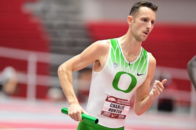 Oregon's Charlie Hunter runs his 800-meter leg during the Ducks' record-setting distance medley relay on Friday at the Razorback Invitational in Fayetteville, Arkansas.