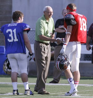 Jim Craig (middle) shakes hands with a player during a break in the 2013 Canton Repository East-West All-Star Football Classic. (CantonRep.com / Scott Heckel)