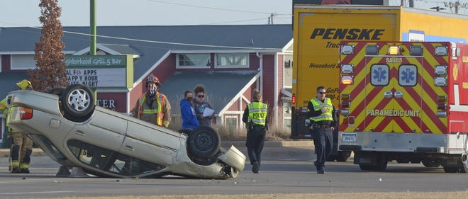 Emergency responders attend to a rollover crash on S. 9th Street in front of Walmart about 4:22 p.m. in Salina on Monday. Salina police diverted southbound traffic temporarily. The driver was able to escape the vehicle with no injuries.