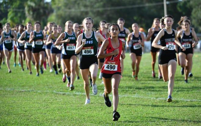 Palmetto High's Priya Wilson (center, #490) leads the pack off the starting line during the Class 3A-District 12 cross country meet hosted by Palmetto High on Oct. 28, 2020. Wilson finished first in the race.